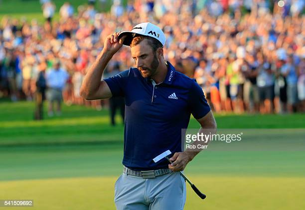 Dustin Johnson of the United States celebrates on the 18th green after winning the US Open at Oakmont Country Club on June 19 2016 in Oakmont...