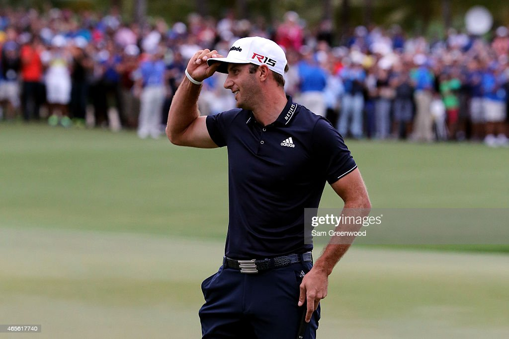 Dustin Johnson of the United States celebrates on the eighteenth hole green after winning the World Golf Championships-Cadillac Championship at Trump National Doral Blue Monster Course on March 8, 2015 in Doral, Florida.