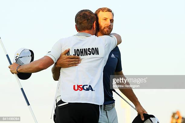 Dustin Johnson of the United States celebrates with caddie Austin Johnson after winning the final round of the US Open at Oakmont Country Club on...