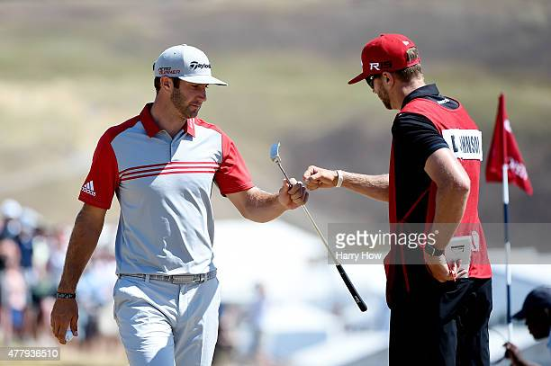 Dustin Johnson of the United States celebrates with his brother/caddie Austin Johnson after a birdie on the fifth hole during the third round of the...