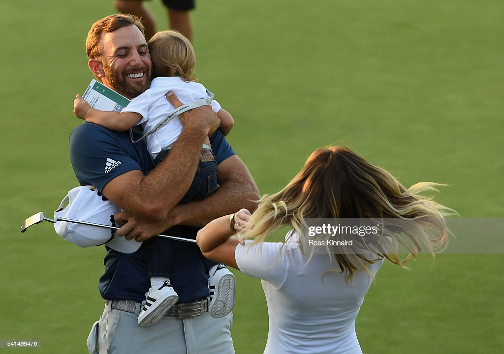 Dustin Johnson of the United States celebrates with partner Paulina Gretzky and son Tatum after winning the final round of the US Open at Oakmont...