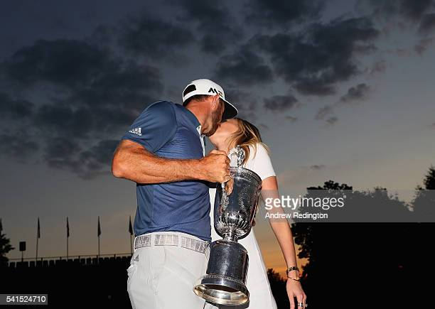 Dustin Johnson of the United States celebrates with partner Paulina Gretzky after winning the US Open at Oakmont Country Club on June 19 2016 in...