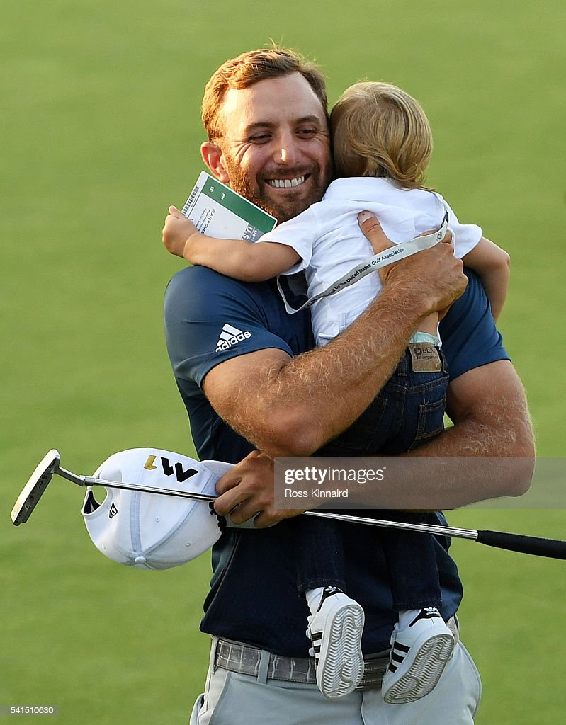 Dustin Johnson of the United States celebrates with son Tatum after winning the U.S. Open at Oakmont Country Club on June 19, 2016 in Oakmont, Pennsylvania.