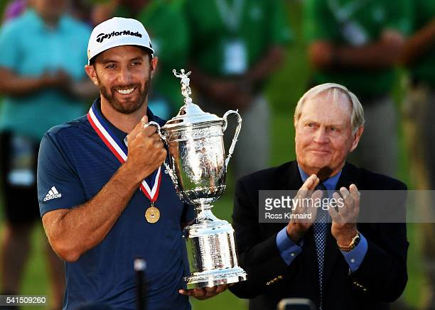 Dustin Johnson of the United States celebrates with the winner's trophy alongside Jack Nicklaus after winning the US Open at Oakmont Country Club on...