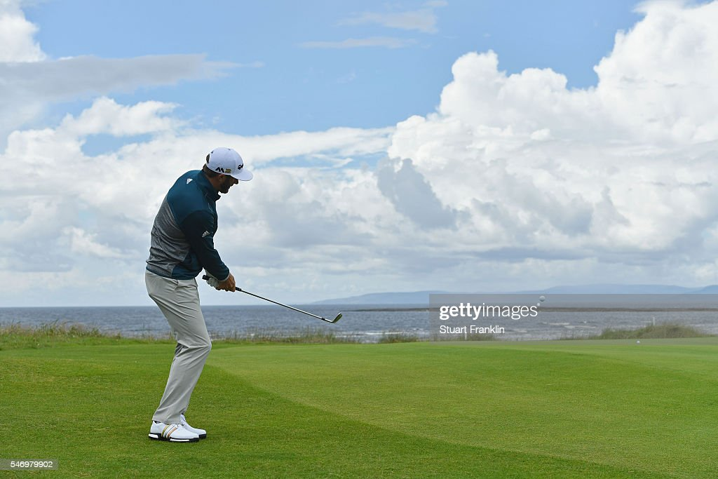Dustin Johnson of the United States chips on to a green during a practice round ahead of the 145th Open Championship at Royal Troon on July 13, 2016 in Troon, Scotland.