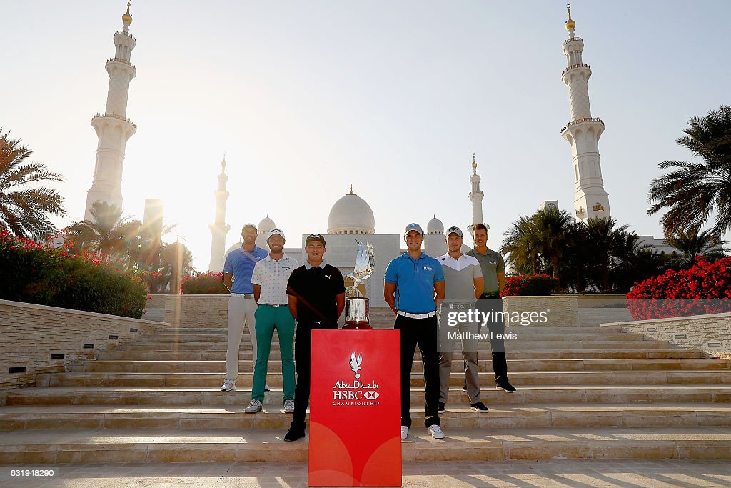 Dustin Johnson, of the United States, Curtis Luck of Australia, Rickie Fowler of the United States, Martin Kaymer of Germany, Danny Willett of England and Henrik Stenson of Sweden pictured with the Abu Dhabi HSBC Championship Trophy ahead of the Abu Dhabi HSBC Golf Championship at Sheikh Zayed Grand Mosque on January 17, 2017 in Abu Dhabi, United Arab Emirates.