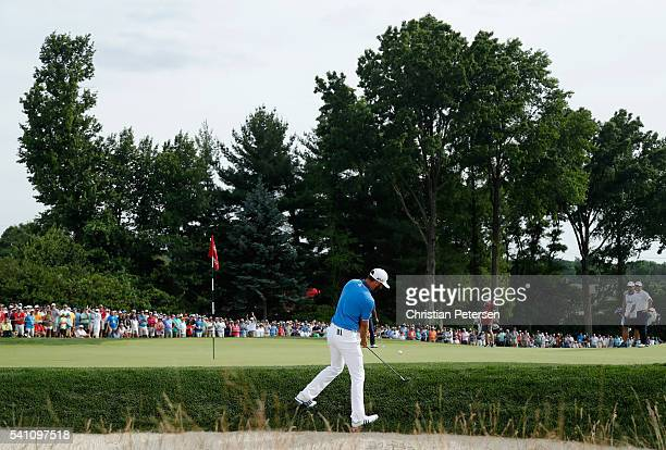 Dustin Johnson of the United States hits a pitch shot behind the second green during the third round of the US Open at Oakmont Country Club on June...
