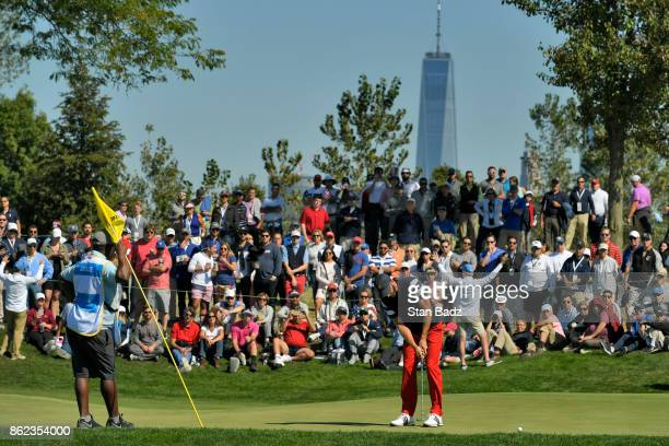 Dustin Johnson of the United States hits a putt on the second hole during the Sunday singles matches at the Presidents Cup at Liberty National Golf...