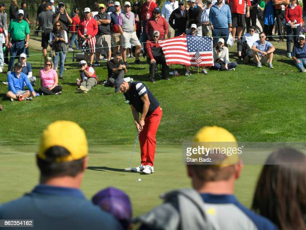 Dustin Johnson of the United States hits a putt on the third hole during the Sunday singles matches at the Presidents Cup at Liberty National Golf...