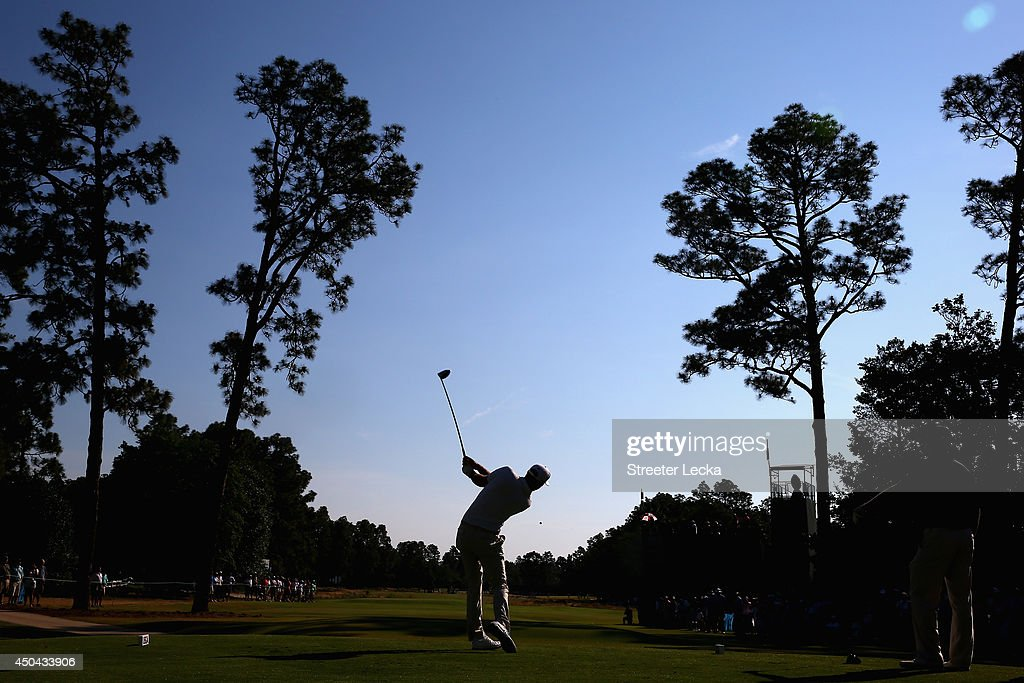 Dustin Johnson of the United States hits a shot during a practice round prior to the start of the 114th U.S. Open at Pinehurst Resort & Country Club, Course No. 2 on June 11, 2014 in Pinehurst, North Carolina.