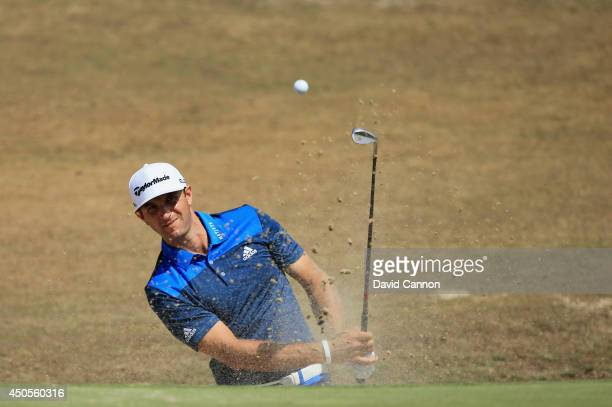 Dustin Johnson of the United States hits a shot from a greenside bunker on the fourth hole during the second round of the 114th US Open at Pinehurst...