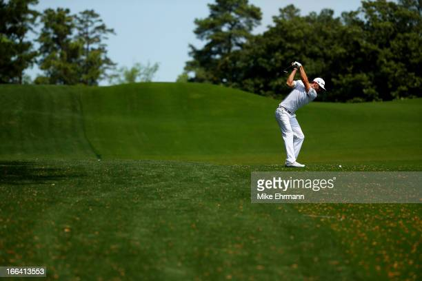 Dustin Johnson of the United States hits a shot from the eighth fairway during the second round of the 2013 Masters Tournament at Augusta National...