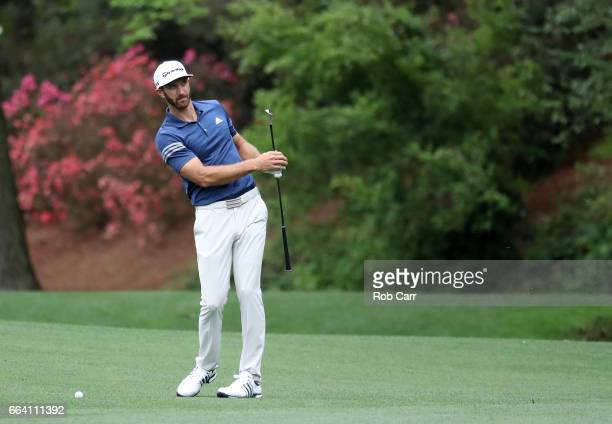 Dustin Johnson of the United States hits a shot on the 13th hole during a practice round prior to the start of the 2017 Masters Tournament at Augusta...