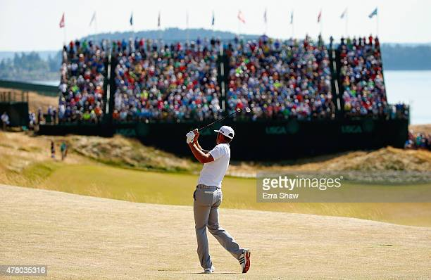 Dustin Johnson of the United States hits a shot on the eighth hole during the final round of the 115th US Open Championship at Chambers Bay on June...