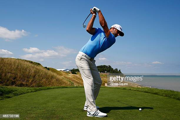 Dustin Johnson of the United States hits a tee shot during a practice round prior to the 2015 PGA Championship at Whistling Straits on August 12 2015...