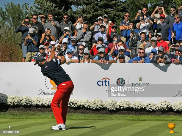 Dustin Johnson of the United States hits a tee shot on the fourth hole during the Sunday singles matches at the Presidents Cup at Liberty National...