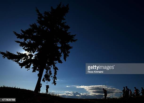 Dustin Johnson of the United States hits his tee shot on the 16th hole during the second round of the 115th US Open Championship at Chambers Bay on...