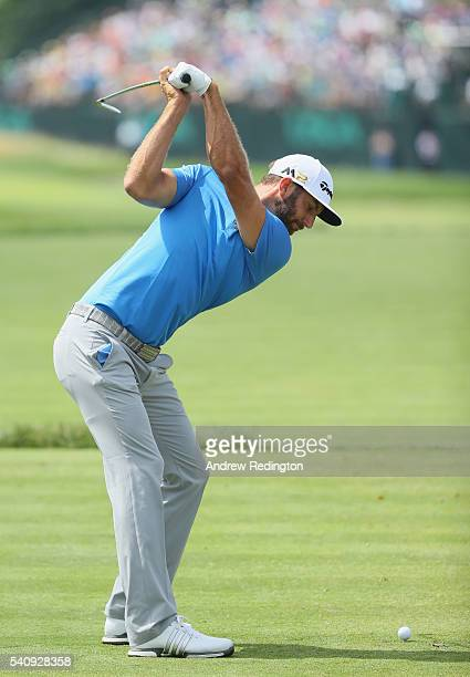 Dustin Johnson of the United States hits his tee shot on the eighth hole during the continuation of the weather delayed first round of the US Open at...