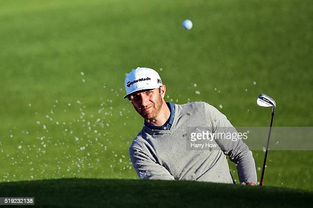 Dustin Johnson of the United States hits out of a bunker during a practice round prior to the start of the 2016 Masters Tournament at Augusta...