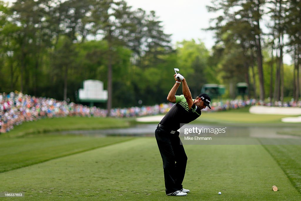 Dustin Johnson of the United States hits the ball on the 16th hole during the first round of the 2013 Masters Tournament at Augusta National Golf Club on April 11, 2013 in Augusta, Georgia.