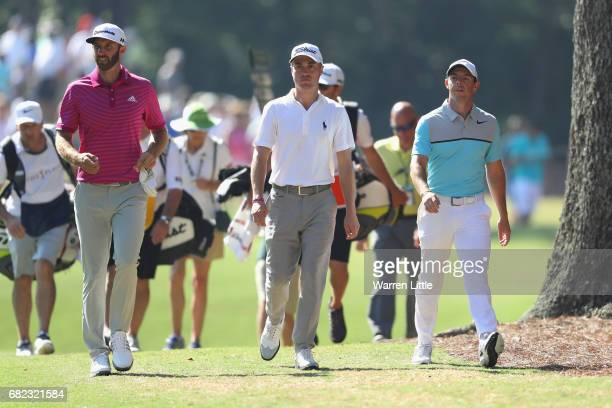 Dustin Johnson of the United States Justin Thomas of the United States and Rory McIlroy of Northern Ireland walk on the 15th hole during the second...