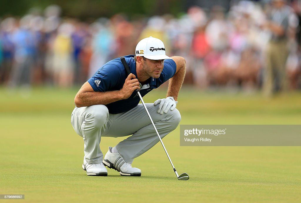 Dustin Johnson of the United States lines up a putt on the 18th green during the final round of the RBC Canadian Open at Glen Abbey Golf Club on July 24, 2016 in Oakville, Canada.