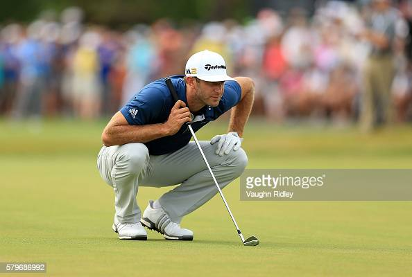 Dustin Johnson of the United States lines up a putt on the 18th green during the final round of the RBC Canadian Open at Glen Abbey Golf Club on July...