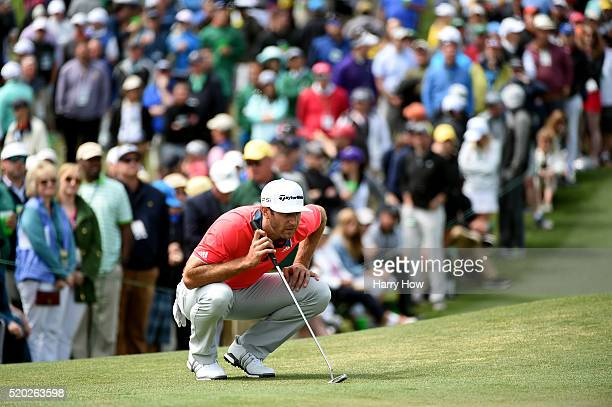 Dustin Johnson of the United States lines up a putt on the second green during the final round of the 2016 Masters Tournament at Augusta National...