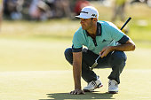 Dustin Johnson of the United States lines up his putt on the sixteenth hole during round three of the 2016 RBC Canadian Open at Glen Abbey Golf...
