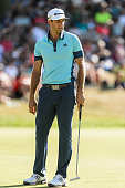 Dustin Johnson of the United States looks on after putting on the sixteenth during round three of the 2016 RBC Canadian Open at Glen Abbey Golf...