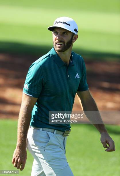 Dustin Johnson of the United States looks on from the third hole during a practice round prior to the start of the 2017 Masters Tournament at Augusta...