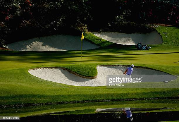 Dustin Johnson of the United States plays a bunker shot on the 12th hole during the third round of the 2015 Masters Tournament at Augusta National...