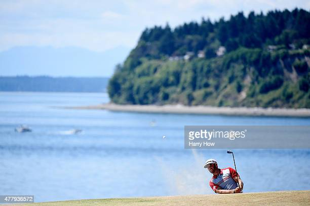 Dustin Johnson of the United States plays a bunker shot on the second hole during the third round of the 115th US Open Championship at Chambers Bay...