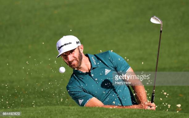 Dustin Johnson of the United States plays a shot from a bunker on the second hole during a practice round prior to the start of the 2017 Masters...