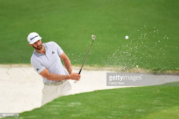 Dustin Johnson of the United States plays a shot from a bunker on the tenth hole during a practice round prior to the start of the 2017 Masters...