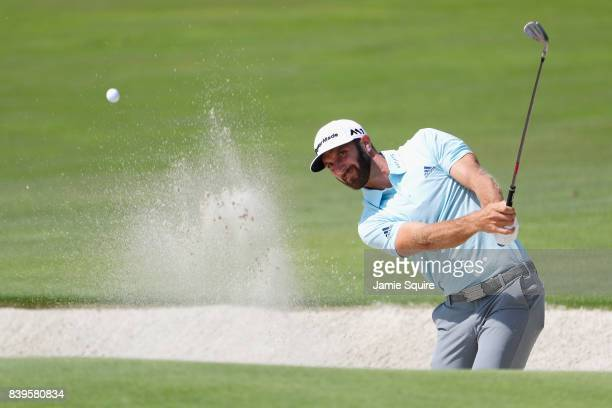 Dustin Johnson of the United States plays a shot from a bunker on the third hole during round three of The Northern Trust at Glen Oaks Club on August...