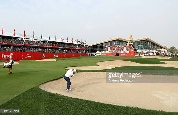 Dustin Johnson of the United States plays from a bunker on the 18th during the second round of the Abu Dhabi HSBC Championship at the Abu Dhabi Golf...