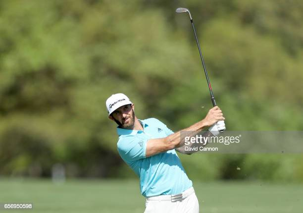 Dustin Johnson of the United States plays his second shot on the par 4 first hole in his match against Martin Kaymer during the second round of the...