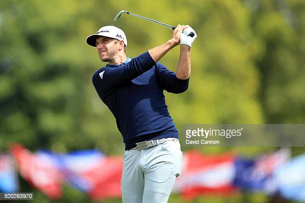 Dustin Johnson of the United States plays his second shot on the first hole during the final round of the 2016 Masters Tournament at Augusta National...