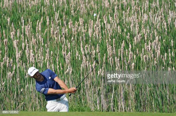 Dustin Johnson of the United States plays his shot during a practice round prior to the 2017 US Open at Erin Hills on June 13 2017 in Hartford...