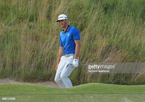 Dustin Johnson of the United States plays his shot from a bunker on the 16th hole during the second round of the 2017 US Open at Erin Hills on June...