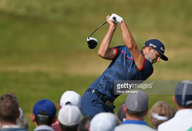 Dustin Johnson of the United States plays his shot from the 12th tee during the first round of the 2017 US Open at Erin Hills on June 15 2017 in...