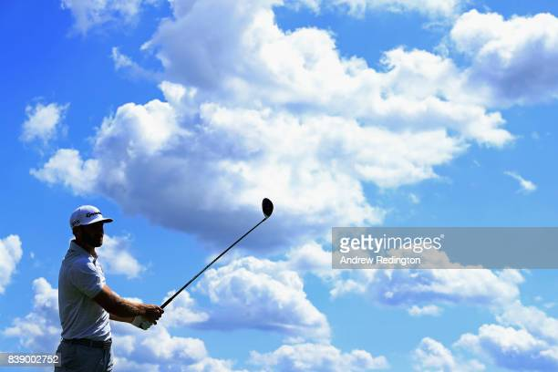 Dustin Johnson of the United States plays his shot from the ninth tee during round two of The Northern Trust at Glen Oaks Club on August 25 2017 in...