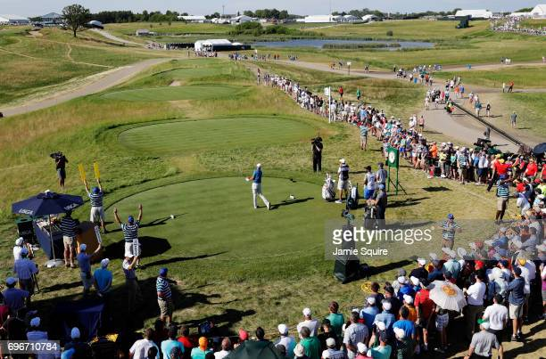 Dustin Johnson of the United States plays his shot from the tenth tee during the second round of the 2017 US Open at Erin Hills on June 16 2017 in...