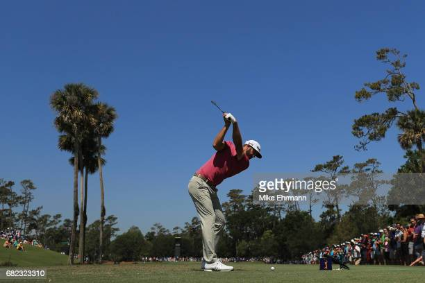Dustin Johnson of the United States plays his shot from the third tee during the second round of THE PLAYERS Championship at the Stadium course at...