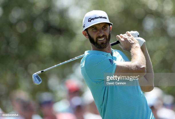Dustin Johnson of the United States plays his tee shot on the par 3 seventh hole in his match against Martin Kaymer during the second round of the...