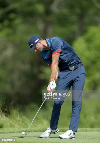 Dustin Johnson of the United States plays his tee shot on the par 3 16th hole during the first round of the 117th US Open Championship at Erin Hills...