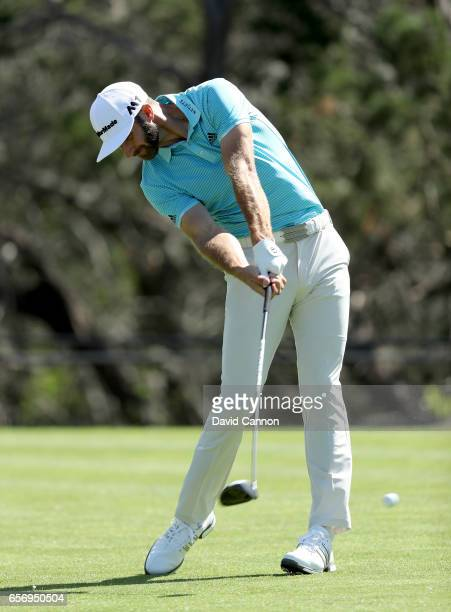 Dustin Johnson of the United States plays his tee shot on the par 4 second hole in his match against Martin Kaymer during the second round of the...