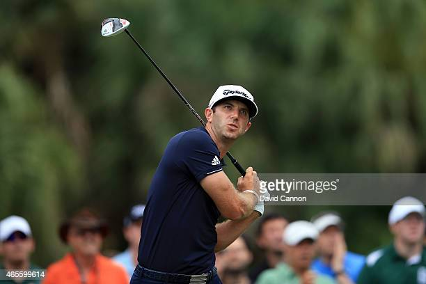 Dustin Johnson of the United States plays his tee shot on the seventh hole during the final round of the World Golf ChampionshipsCadillac...
