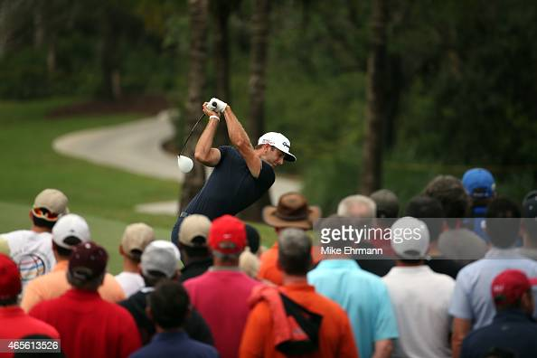Dustin Johnson of the United States plays his tee shot on the twelfth hole during the final round of the World Golf ChampionshipsCadillac...